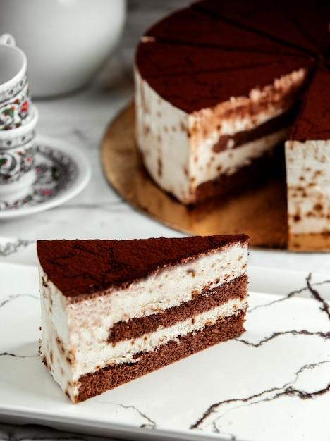 Side view of slice of tiramisu cake on plate Free Photo