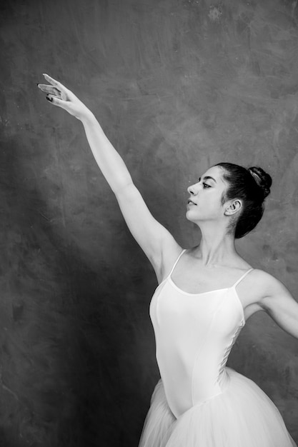 Side view smiley ballerina greyscale Free Photo