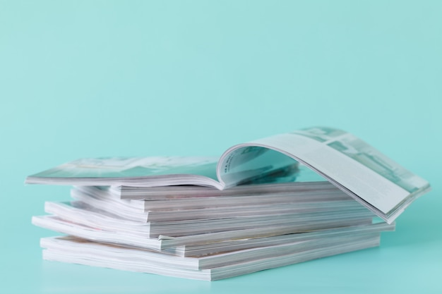 Side view of a stack of magazines with glossy paper Premium Photo