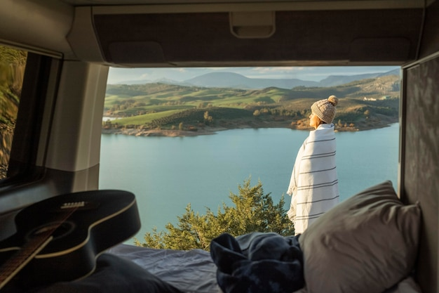 Side view of woman admiring nature while on a road trip Free Photo