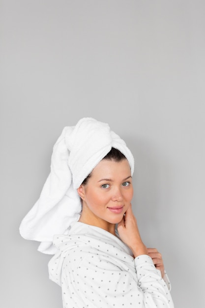 Side view of woman in bathrobe and towel showing beautiful face Free Photo