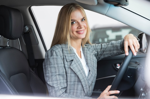 Side view of woman in car Free Photo