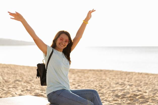Side view of woman enjoying the beach Free Photo