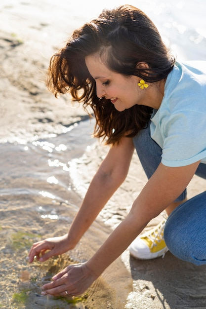 Side view of woman enjoying clean water in nature Free Photo