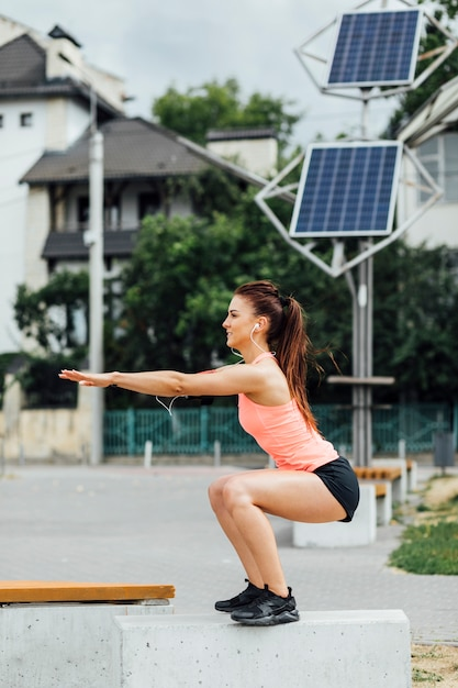 Side view of woman exercising Free Photo