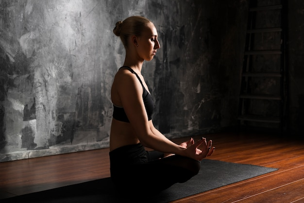 Side view woman meditating position Free Photo