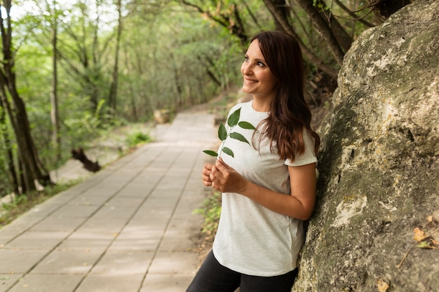 Side view of woman posing in nature Free Photo