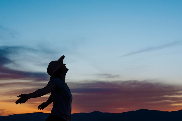 Side view of woman posing at sunset in nature Premium Photo