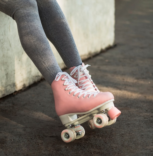 Side view of woman in socks with roller skates Free Photo