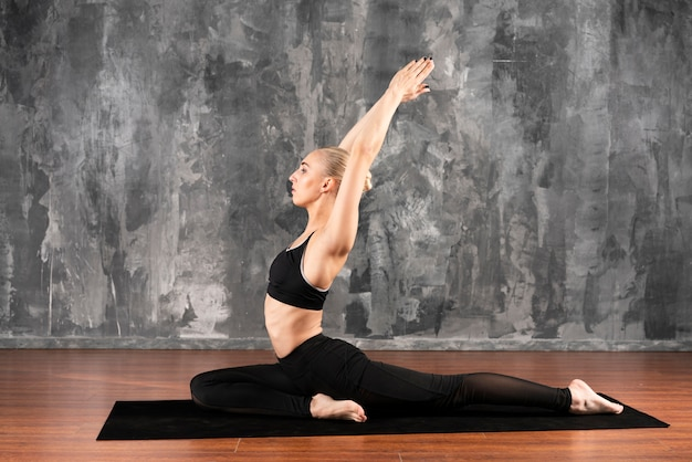Side view woman stretching at home Free Photo