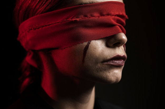Side view of woman with red blindfold Premium Photo