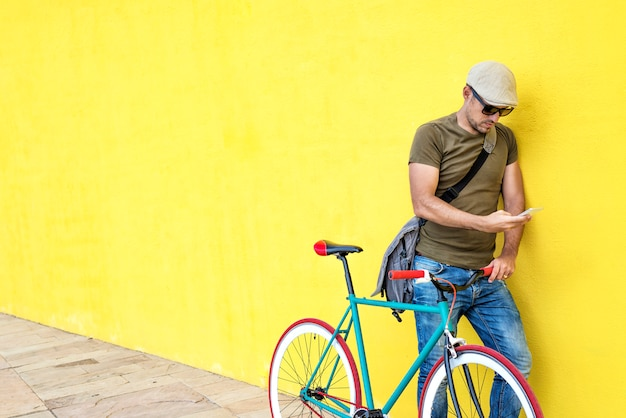 Side view of a young adult man with a vintage bike Premium Photo