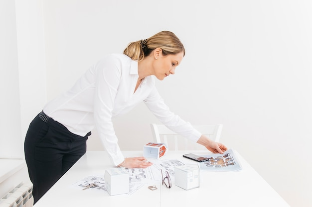 Side view of young businesswoman working in office Free Photo