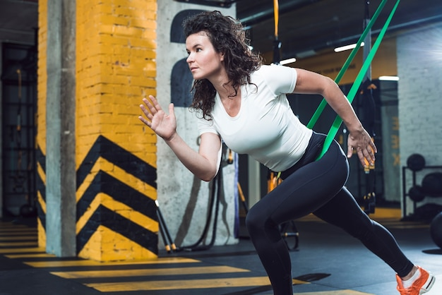 Side view of a young woman doing exercise Free Photo