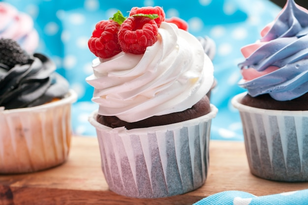 Side view of yummy cupcakes with assorted flavor. shot on the table Premium Photo
