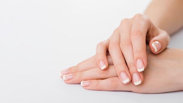 Sideview of manicured hands with copy space Free Photo