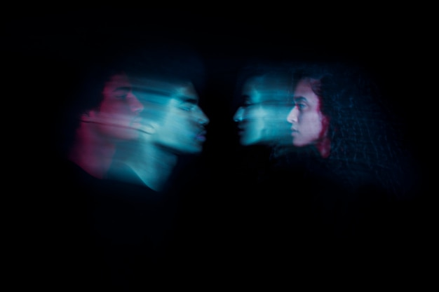 Sideways couple with double exposure effect Free Photo