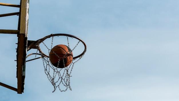 Sideways low view basketball hoop Free Photo