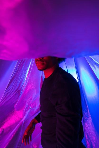 Sideways man with plastic foil Free Photo