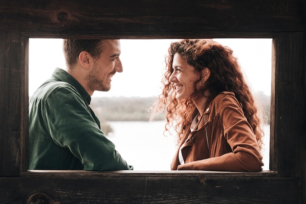 Sideways smiling couple looking at each other Free Photo