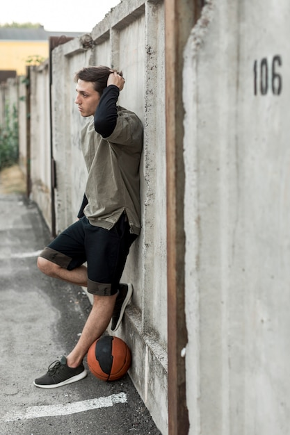 Sideways urban basketball player posing Free Photo