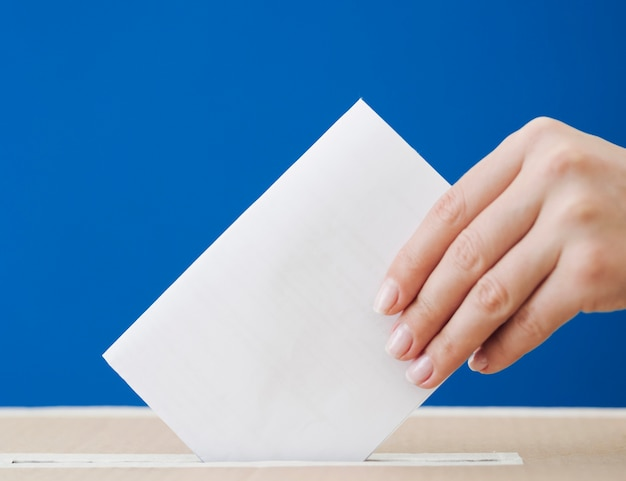 Sideways woman being involved in election mock-up Free Photo
