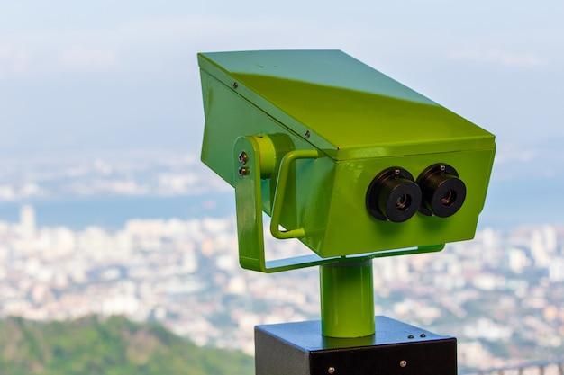 Sightseeing binoculars overlooking top view of georgetown, capital of penang island, malaysia Premium Photo