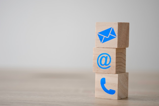 Sign of e-mail , address and telephone print screen on wooden block cube for business marketing contact website page. Premium Photo