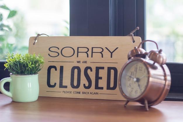 A sign hanging off coffee shop door Premium Photo