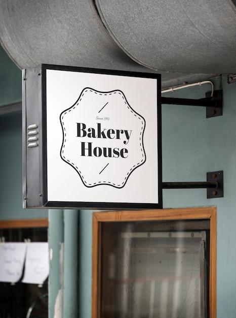 Sign on a modern shop mockup Premium Photo
