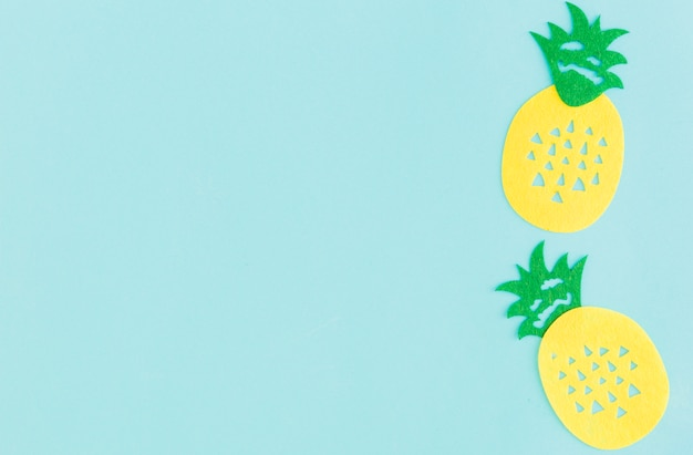 Sign of pineapple on light background Free Photo