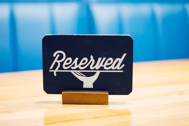 The sign reserved on the empty table in a cafe Premium Photo