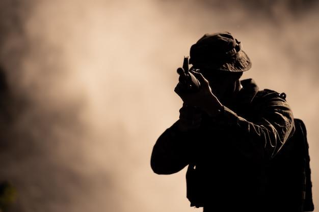 Silhouette action soldiers Premium Photo