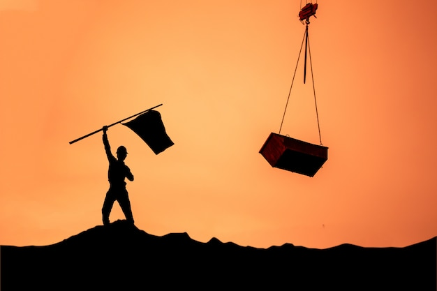 Silhouette of the businessman,success had been difficult. Premium Photo