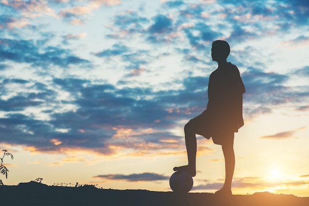 Silhouette of children play soccer football Free Photo