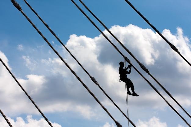 Silhouette of construction climber Premium Photo