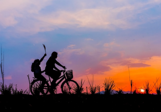Premium Photo | Silhouette of couple driving bike happy time sunset
