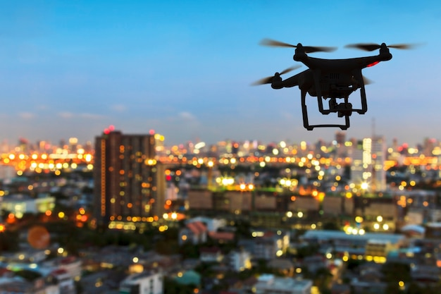Silhouette of drone flying Premium Photo