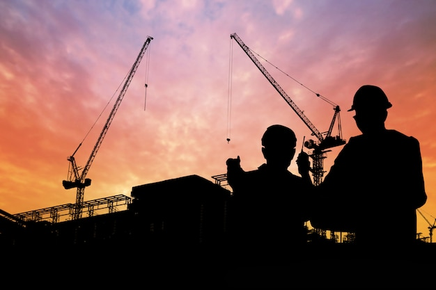 Silhouette of engineers with worker in construction building Premium Photo