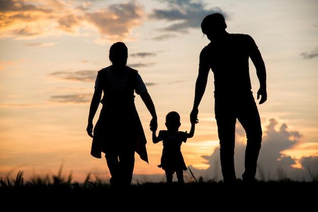 Silhouette of family happy parents having fun Premium Photo
