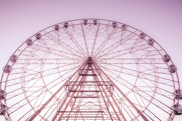 Silhouette of ferris wheel on the background of blue sky Premium Photo