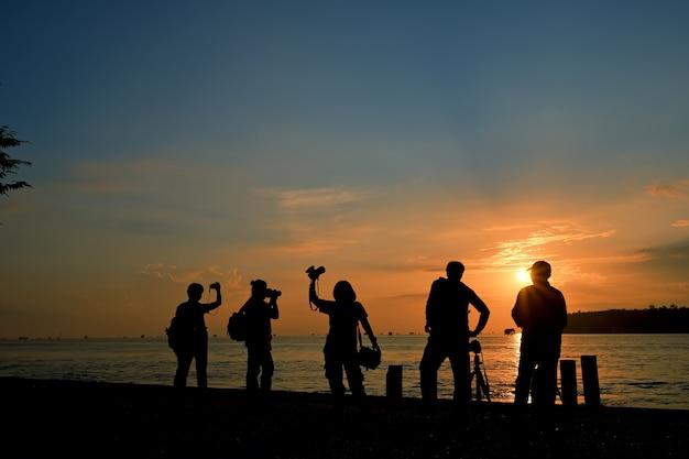 Silhouette group camera man Premium Photo