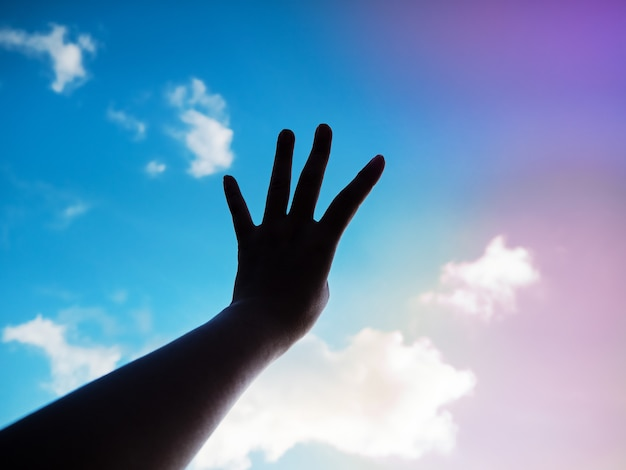 The silhouette hand showing four finger up in the air Premium Photo