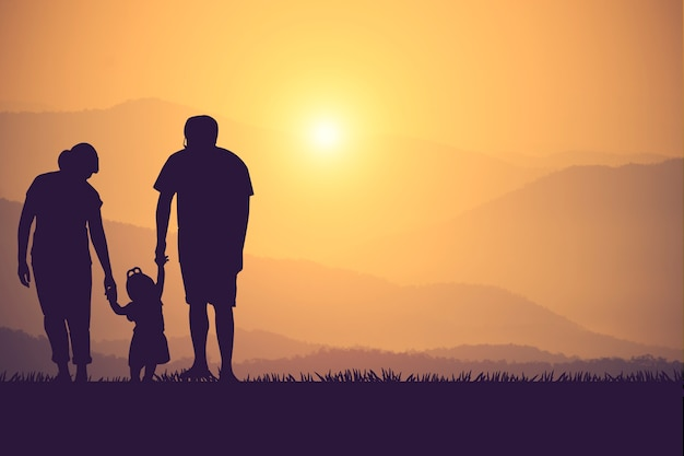 Silhouette of a happy family and happy time sunset Premium Photo