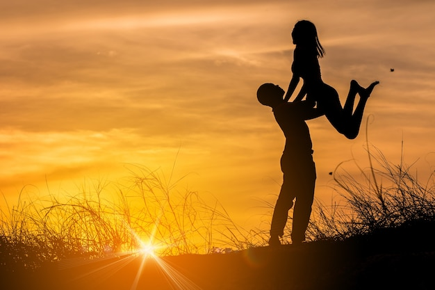 Silhouette Of Happy Guy Holding His Girlfriend On The Beach Sunset Background Photo -8541