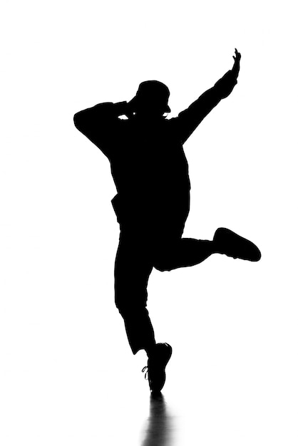 Silhouette of hip hop dancer is showing some movements