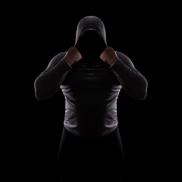 Silhouette male fight club in a hood without face Premium Photo