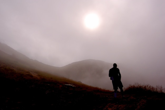 Silhouette of man on a foggy day Free Photo