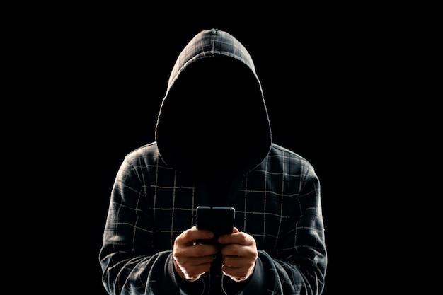 Silhouette of a man in a hood Premium Photo