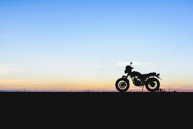 Silhouette of motorcycle with sunset background Premium Photo